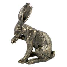 Hare Licking Paw Figurine
